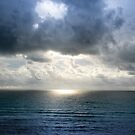 Cancun, Mexico sunrise on a cloudy day by David Owens