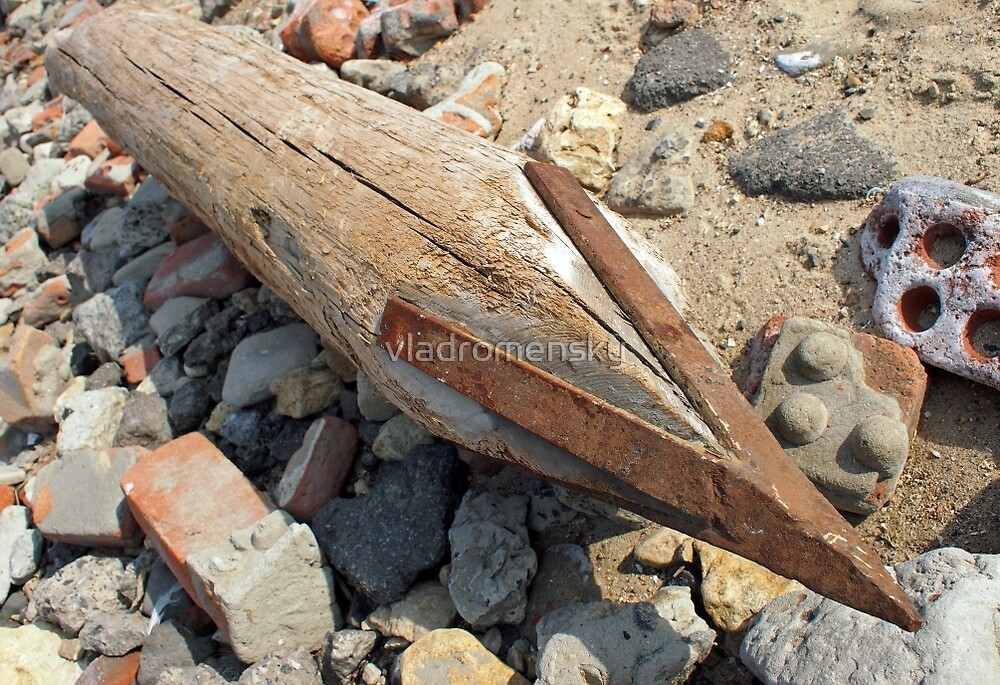 Wooden pole with an iron tip at a construction site by vladromensky