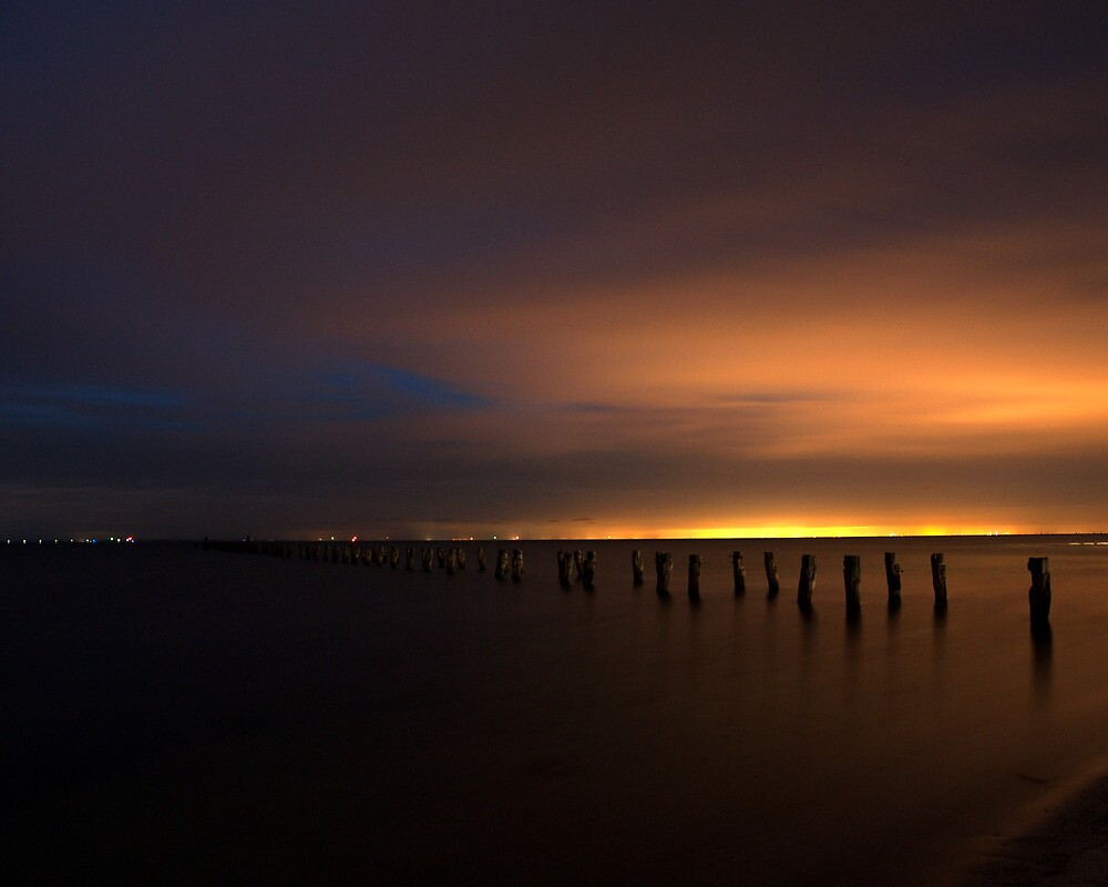 Clifton Springs Jetty with the Lights of Melbourne. by John Sharp