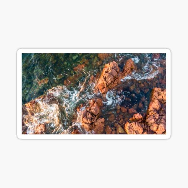 Waves Crashing Over the Rocky Beach Sticker
