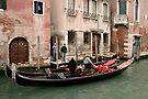 Gondolas, Gondoliers and Buildings, Venice, Italy by Gerda Grice