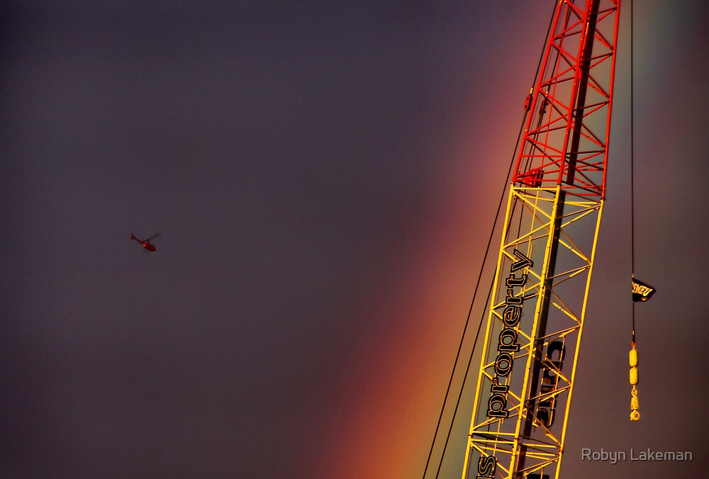 Helicopter flying into a rainbow by Robyn Lakeman
