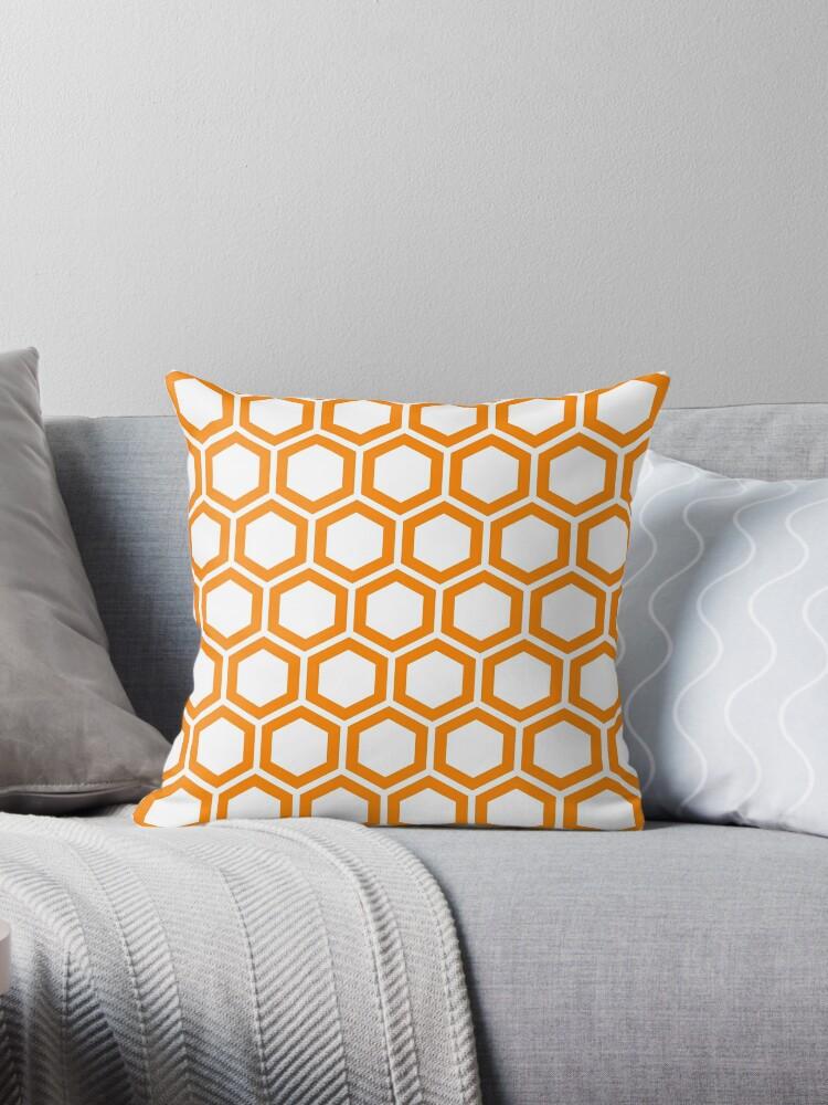 Orange honeycomb pattern on white background by ImageNugget
