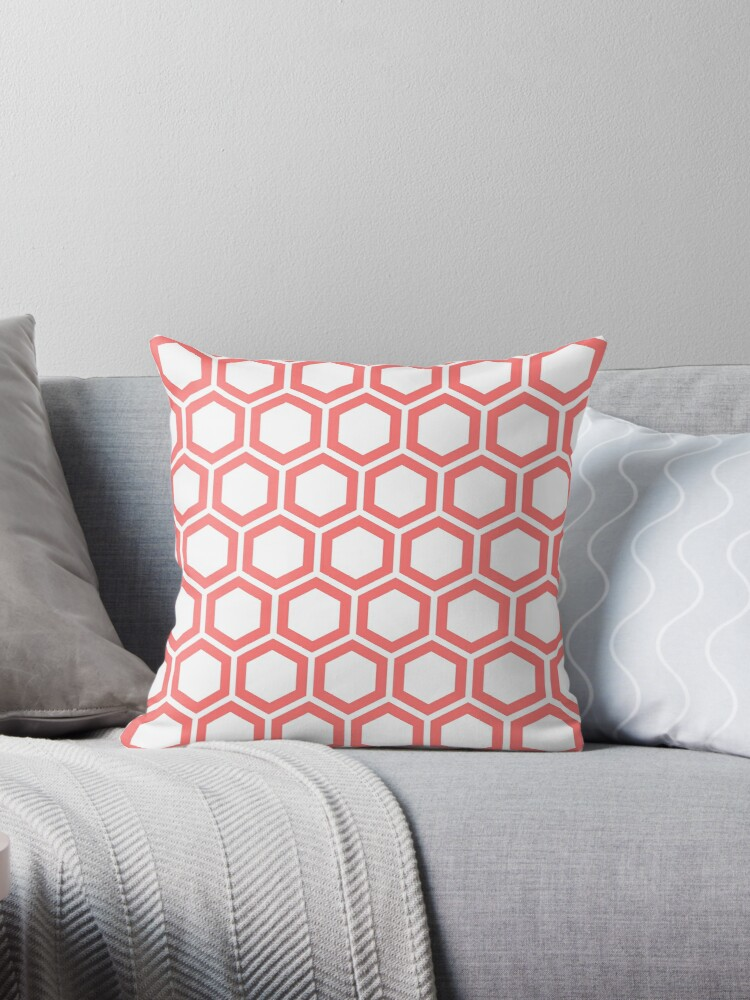 Pink honeycomb pattern on white background by ImageNugget