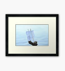 Blurred silhouette of a sailboat Framed Print