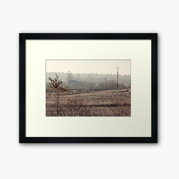 Village in morning mist at autumn time Framed Art Print