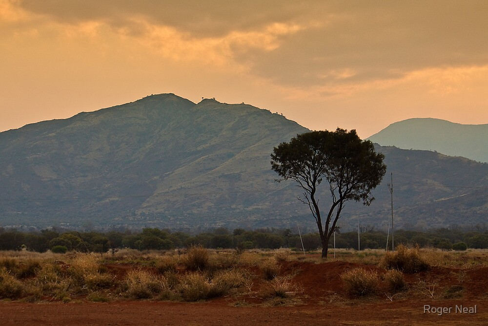 Amata - a dusty sunset by Roger Neal
