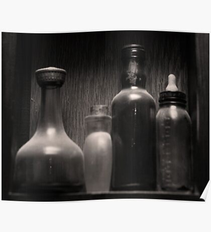 Four Antique Bottles Poster