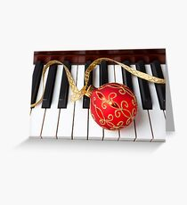 Christmas ornament on piano keys Greeting Card