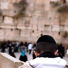 praying boy at wailing wall by johnnabrynn