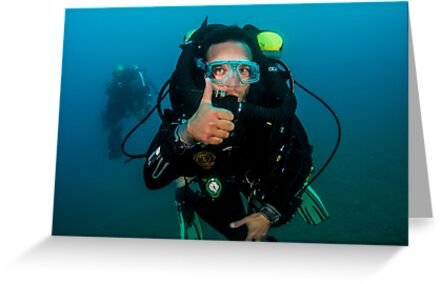 scuba diver demonstrates the sign language for divers. by PhotoStock-Isra