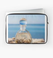 A bottle with seashells on the beach selective focus on the foreground  Laptop Sleeve