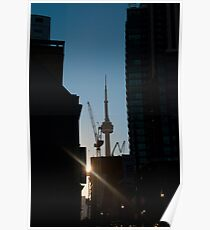 Sun Setting On CN Tower Framed By Towers Poster
