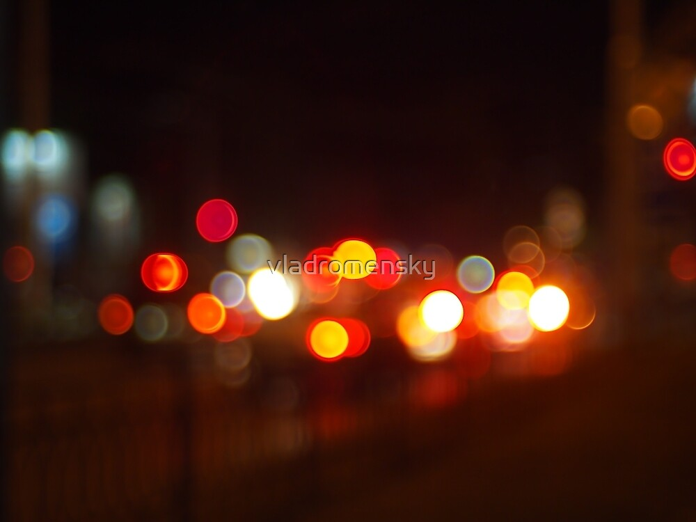 Abstract and blur colored lights of the night city by vladromensky