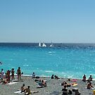 Sailing boats at the beach in Nice, France by Jekusha