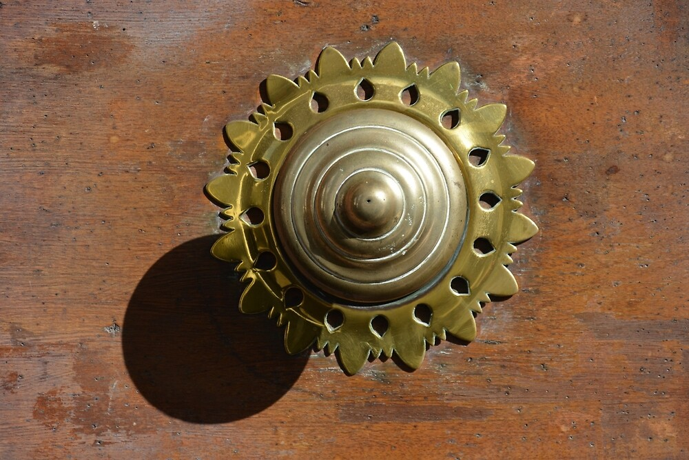 Doorknob with shadow by Arie Koene