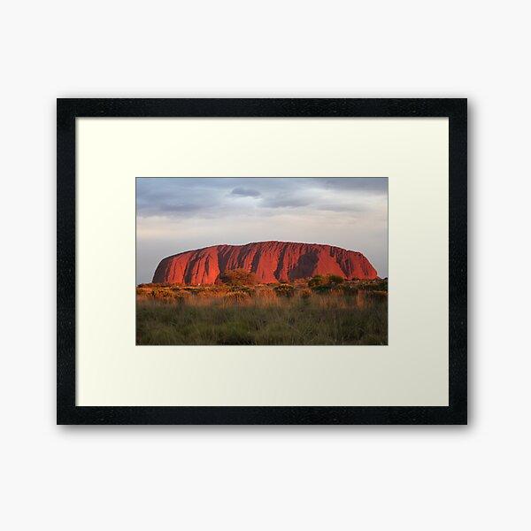 Setting sun shines on Uluru Framed Art Print