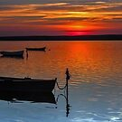 Sunset over Fleet boats by Alan Forder