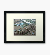 A rooftop view of rooftops Framed Print