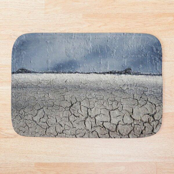 Cracked desert / mixed media painting Bath Mat