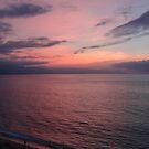 Pink evening sky reflected by the ocean - Cielo rosa reflectado en el mar, Puerto Vallarta, Mexico by PtoVallartaMex