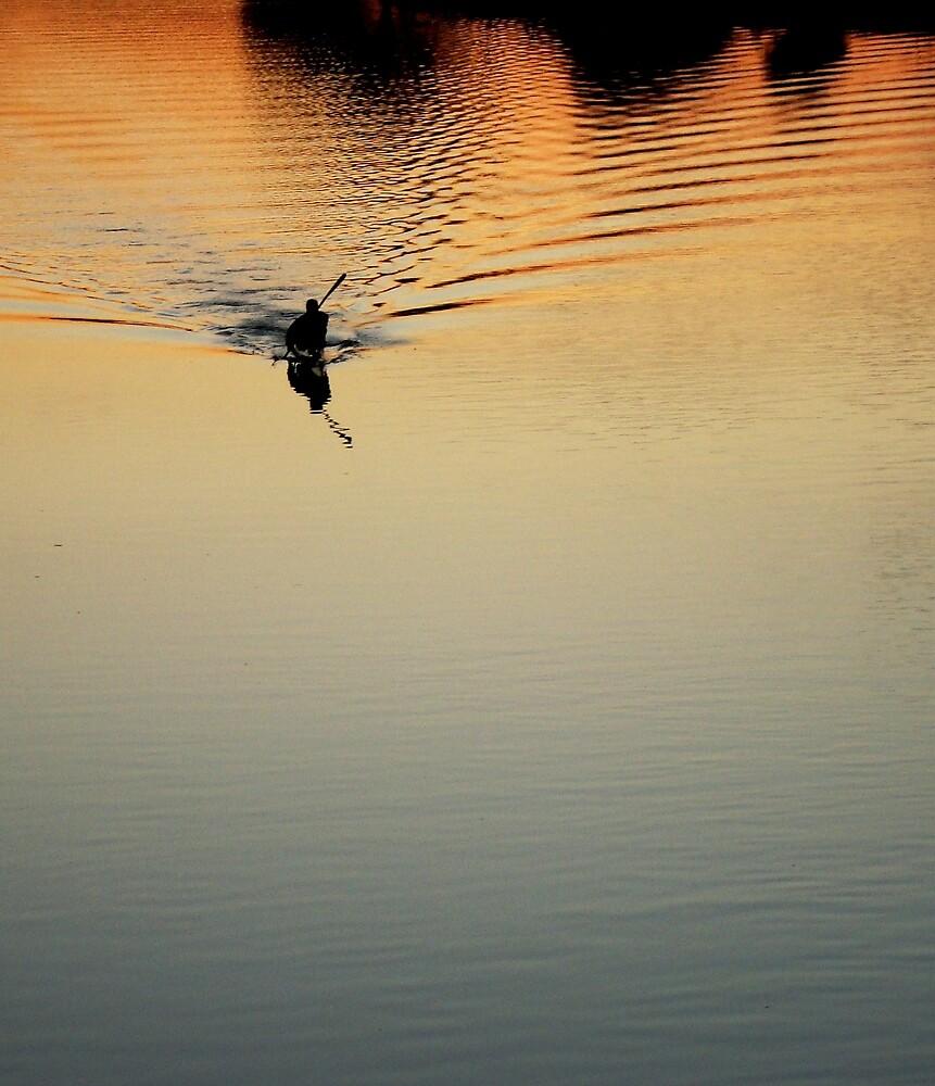 kayak at sunset by Pat Heddles