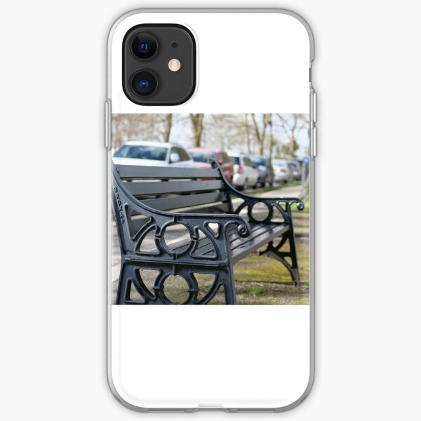 Bench for people to sit along the Thames river embankment in Windsor, Berkshire, England, UK iPhone Soft Case