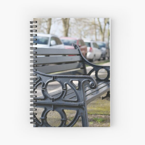 Bench for people to sit along the Thames river embankment in Windsor, Berkshire, England, UK Spiral Notebook