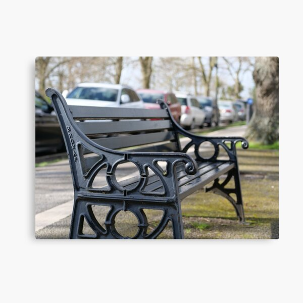 Bench for people to sit along the Thames river embankment in Windsor, Berkshire, England, UK Canvas Print