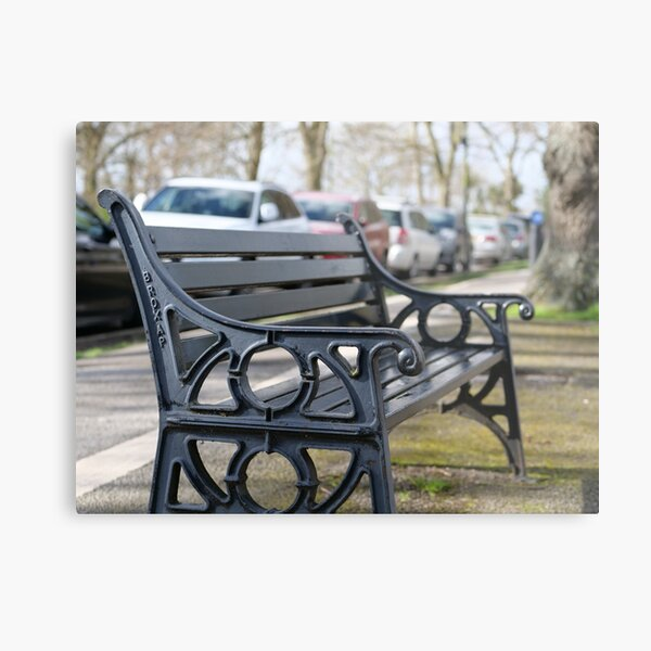 Bench for people to sit along the Thames river embankment in Windsor, Berkshire, England, UK Metal Print