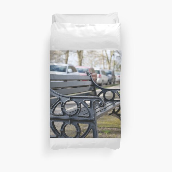 Bench for people to sit along the Thames river embankment in Windsor, Berkshire, England, UK Duvet Cover