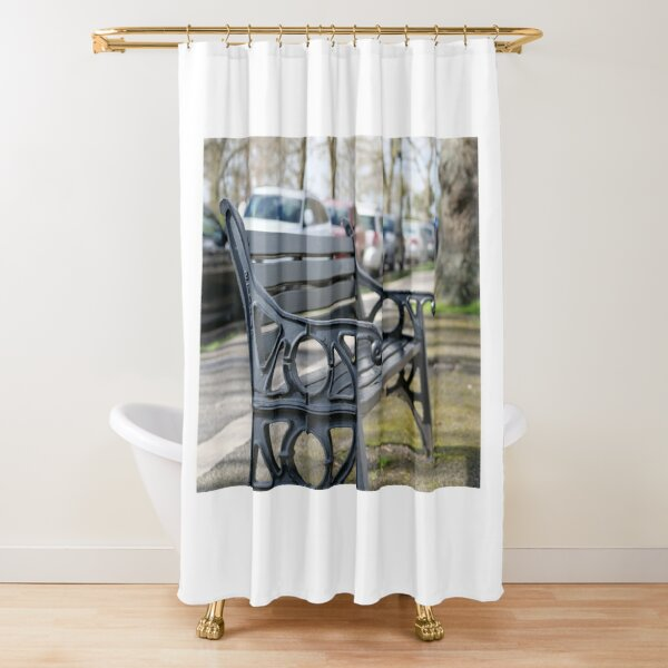 Bench for people to sit along the Thames river embankment in Windsor, Berkshire, England, UK Shower Curtain