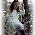 swinging pretty by Sandra Hopko