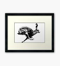 bounding hare white Framed Print