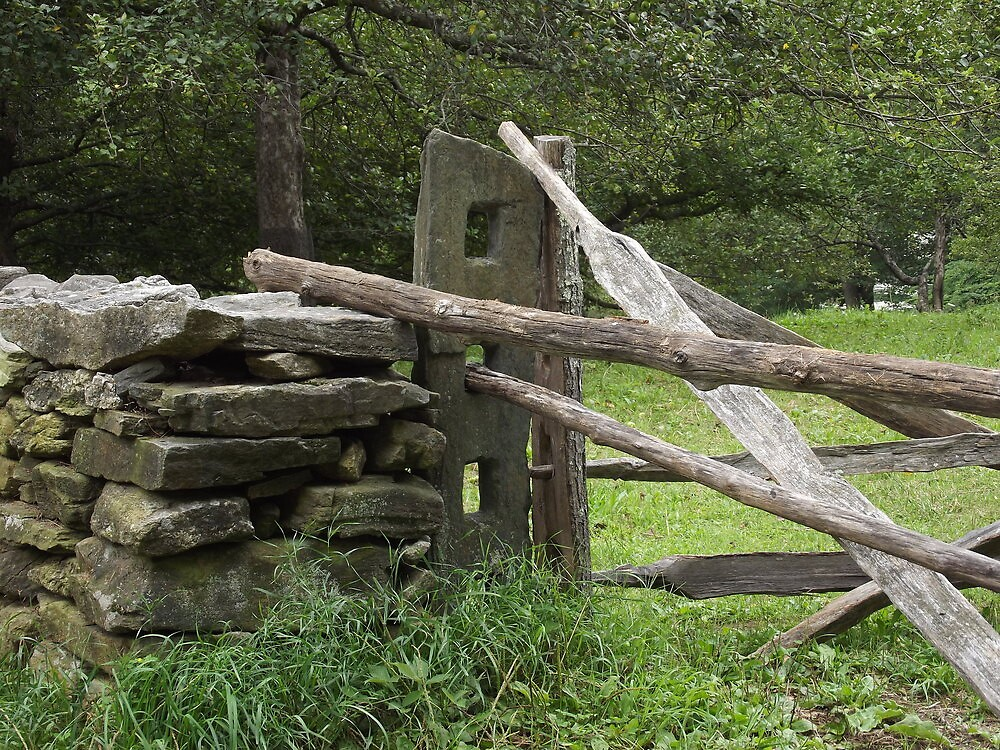 rock wall and wooden fence by John Sullivan