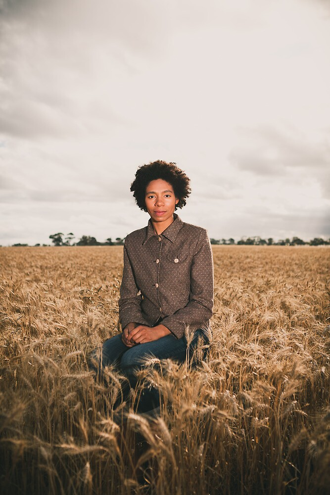 Amirah in the Field - Seated by James Troi