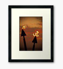 Tiki torches at sunset... Framed Print