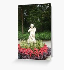 Little angel boy surrounded by bright flowers. Greeting Card