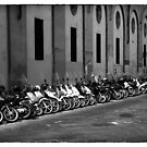 Motor Bikes lined up and parked in Florence Italy by grorr76