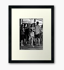 charging through the crowd Framed Print
