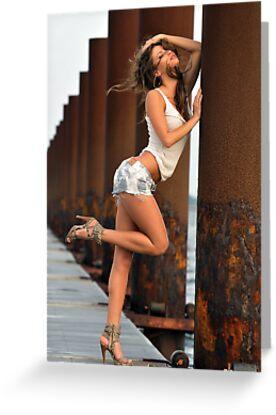 Sexy fashion model posing pretty at rusty boat marina by Anton Oparin