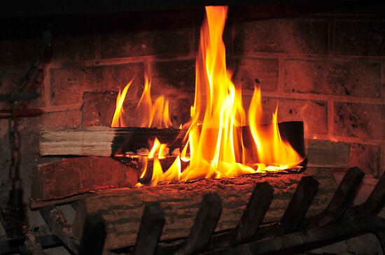 Burning fire at fireplace. Can be used as background. von Anton Oparin