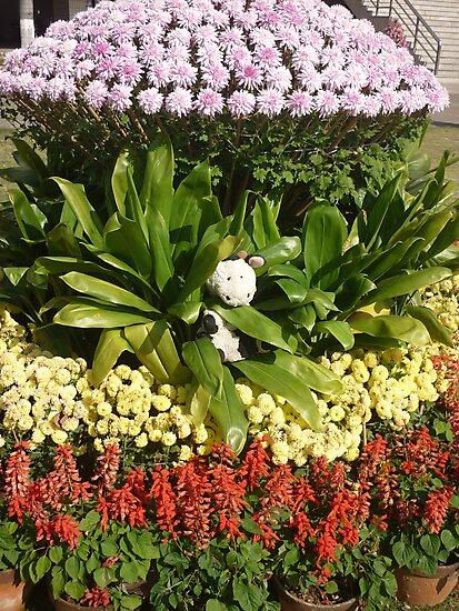 Moo Moo playing in beatiful flowers by Joseph Green