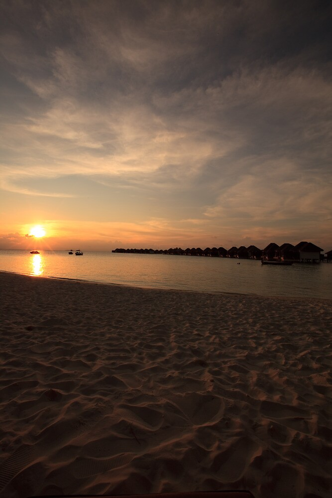 Sunsets in Maldives by Ming Tang