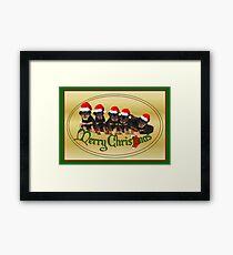 Cute Merry Christmas Rottweiler Puppies Framed Print