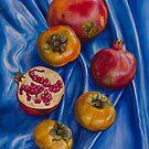 Pomegranates and persimmons on blue silk by Yuliya Glavnaya