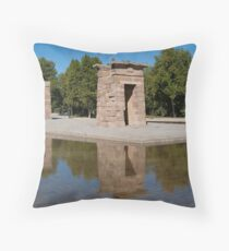 Egyptian temple in Madrid is reflected in surrounding transparent water Throw Pillow