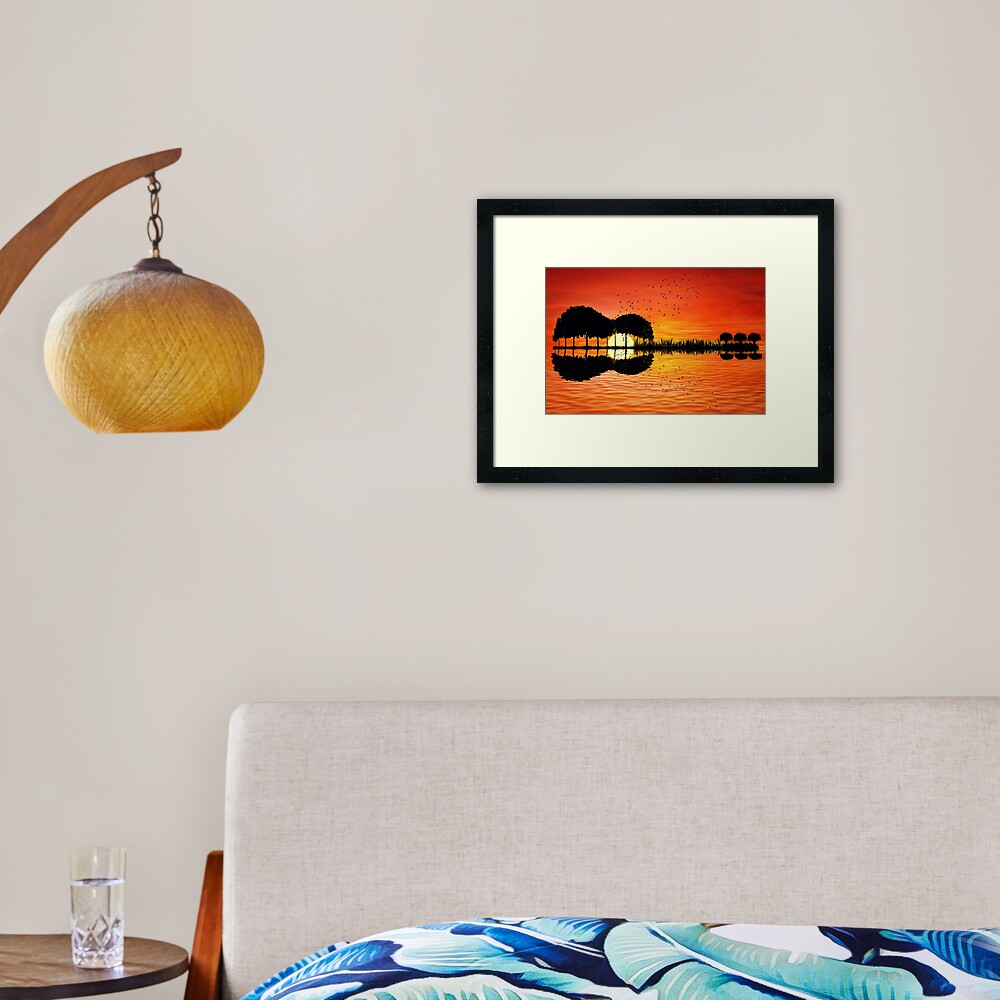 guitar island sunset Framed Art Print