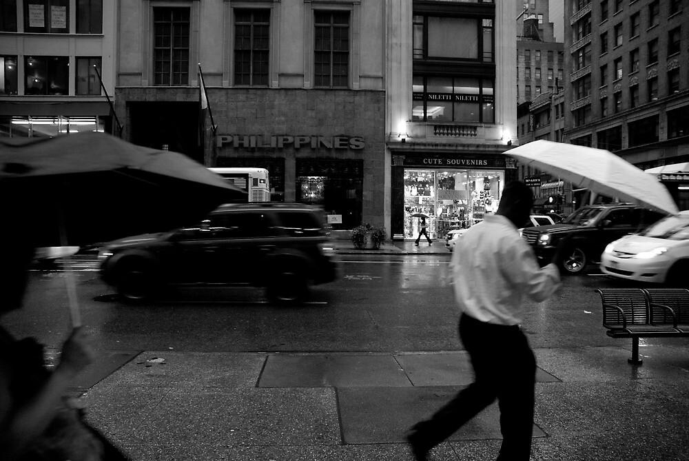 People walking in the rain by alanbuech