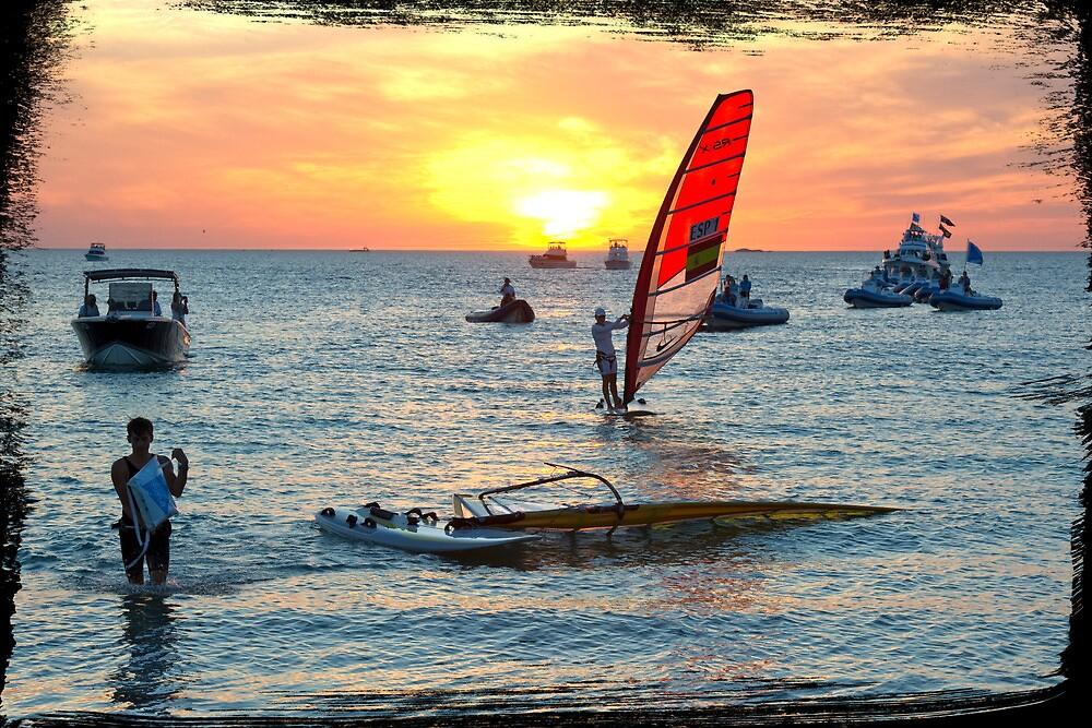 Sailboarders at sunset by Darren Speedie